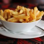 White bowl of french fries