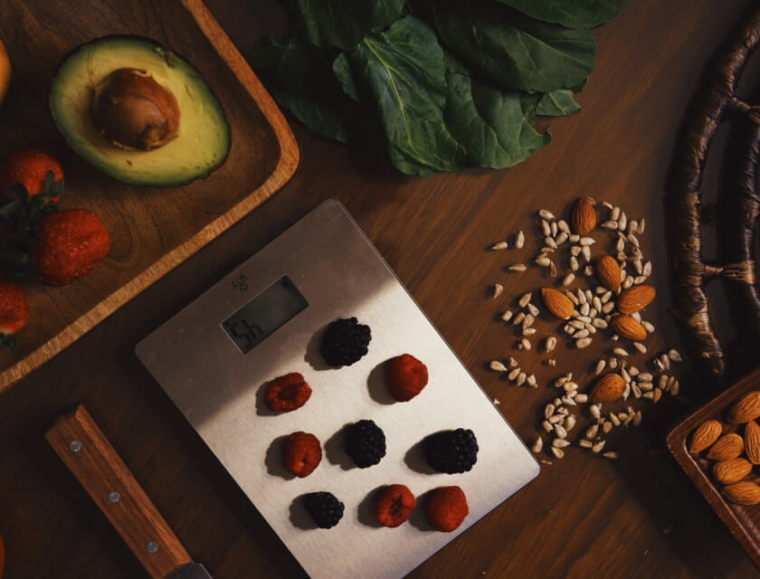 Kitchen scales with berries and organic ingredients for recipe