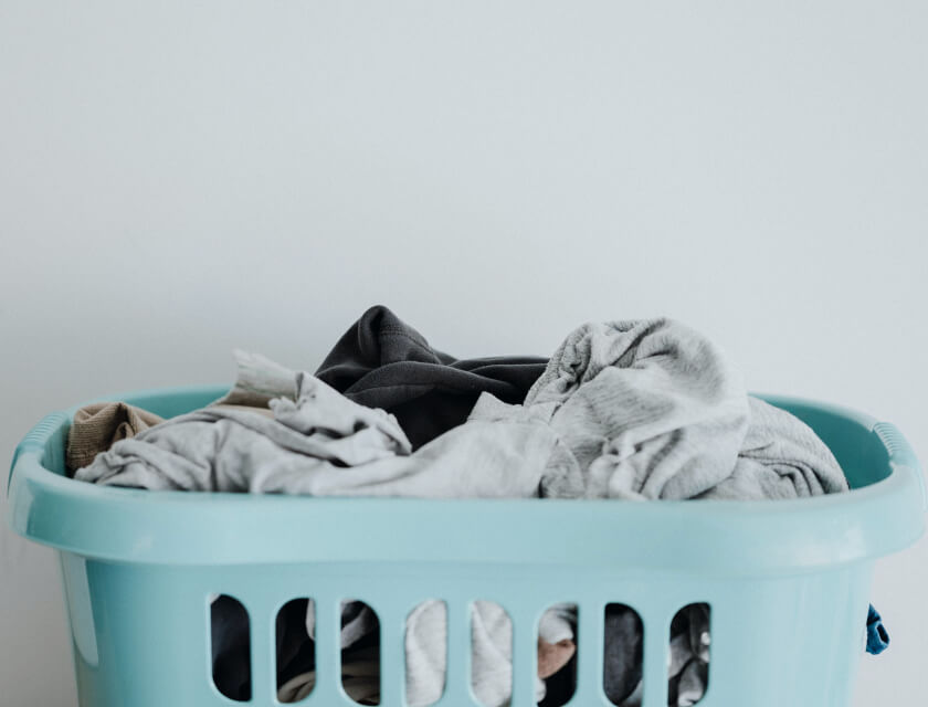 Collapsible laundry basket with a load of washing in it