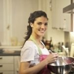 Young woman in the kitchen smiling